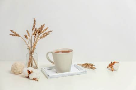 Natural eco home decor with cup coffee candle on wooden tray. Early morning breakfast lifestyle background. Interior decoration with hot drink mug. Hygge scandinavian style concept copy space Imagens