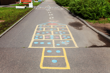 Childrens street mobile game with hand-drawn chalk squares on which to jump.