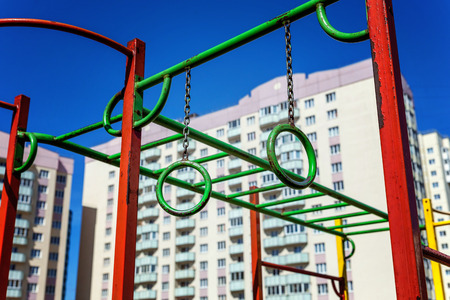 Publics playground in city. Colorful playground on yard in the park. Park with set of modern kids playground background. children Stairs Slides equipment
