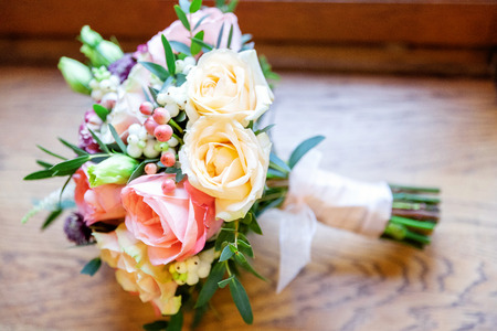 close up of gentle bouquet of the bride in pastel colors with roses