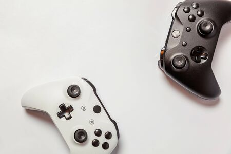 White and black two joystick gamepad, game console isolated on white background. Computer gaming technology play competition videogame control confrontation concept. Cyberspace symbol Stock fotó - 125684271