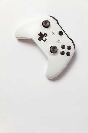 White joystick gamepad, game console isolated on white background. Computer gaming technology play competition videogame control confrontation concept. Cyberspace symbol Stock fotó