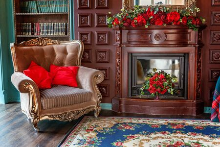 Luxury classic interior of home library. Sitting room with bookshelf, books, arm chair, sofa and fireplace. Clean and modern decoration with elegant furniture. Education read study wisdom concept