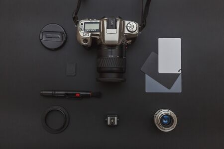 Photographer workplace with dslr camera system, camera cleaning kit, lens and camera accessory on dark black table background. Hobby travel photography concept. Flat lay top view copy space Standard-Bild - 133853337