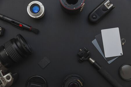 Photographer workplace with dslr camera system, camera cleaning kit, lens and camera accessory on dark black table background. Hobby travel photography concept. Flat lay top view copy space Standard-Bild - 133853345