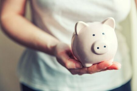 Female woman hands holding pink piggy bank. Saving investment budget business wealth retirement financial money banking concept