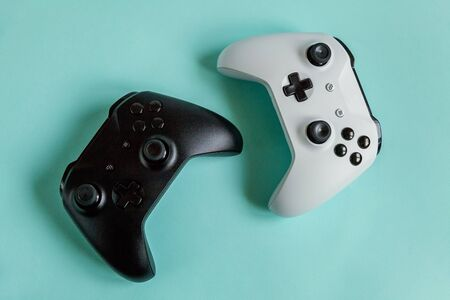 White and black two joystick gamepad, game console isolated on pastel blue colourful trendy background. Computer gaming competition videogame control confrontation concept. Cyberspace symbol Zdjęcie Seryjne