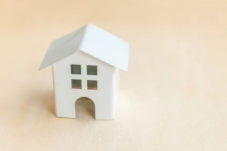 Miniature toy model house on wooden backdrop. Eco Village, abstract environmental background. Real estate mortgage property insurance sweet home ecology concept Фото со стока - 137762064