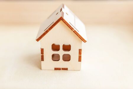 Miniature toy model house on wooden backdrop. Eco Village, abstract environmental background. Real estate mortgage property insurance sweet home ecology concept Фото со стока - 137762080