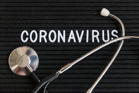 Text phrase Coronavirus and stethoscope on black letter board background. Novel coronavirus 2019-nCoV, MERS-Cov middle East respiratory syndrome coronavirus originating