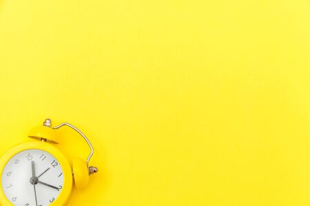Ringing twin bell vintage classic alarm clock Isolated on yellow colourful trendy modern background. Rest hours time of life good morning night wake up awake concept. Flat lay top view copy space Reklamní fotografie