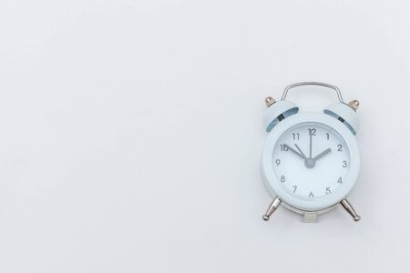 Simply flat lay design Ringing twin bell vintage classic alarm clock Isolated on white background. Rest hours time of life good morning night wake up awake concept. Flat lay top view copy space