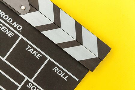 Filmmaker profession. Classic director empty film making clapperboard or movie slate isolated on yellow background. Video production film cinema industry concept. Flat lay top view copy space mock up