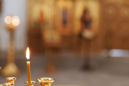 Orthodox Church. Christianity. Festive interior decoration with burning candles and icon in traditional Orthodox Church on Easter Eve or Christmas. Religion faith pray symbol