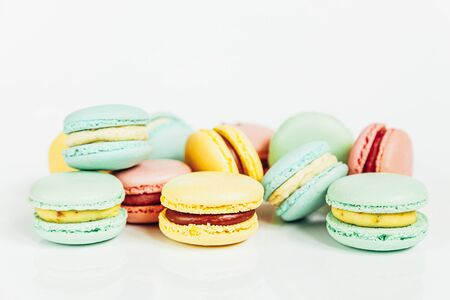 Sweet almond colorful pastel pink blue yellow green macaron or macaroon dessert cake isolated on white background. French sweet cookie. Minimal food bakery concept. Copy space Stock fotó