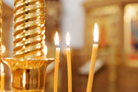 Orthodox Church. Christianity. Festive interior decoration with burning candles and icon in traditional Orthodox Church on Easter Eve or Christmas. Religion faith pray symbol Standard-Bild
