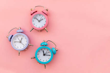Simply minimal design three ringing twin bell classic alarm clock Isolated on pink pastel background. Rest hours time of life good morning night wake up awake concept. Flat lay top view copy space