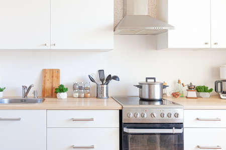 Scandinavian classic minimalistic kitchen with white and wooden details. Modern white kitchen clean contemporary style interior design