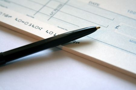 refinancing: Writing a Cheque Stock Photo
