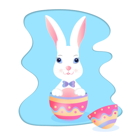 Funny bunny sitting in an Easter egg