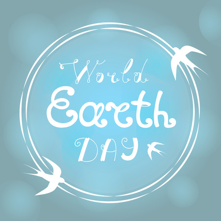 World Earth Day hand littering. Swallows fly around the planet. Stock Photo