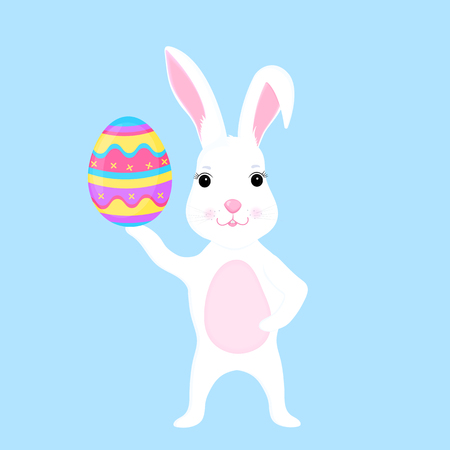 Funny easter bunny holds an paschal egg in its paw.