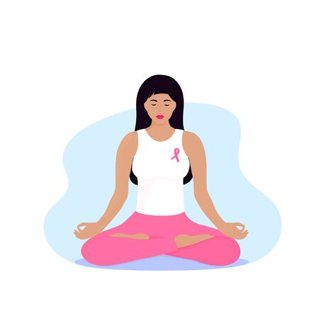 National Breast Cancer Awareness Month. Young woman with a pink ribbon on her chest is meditating