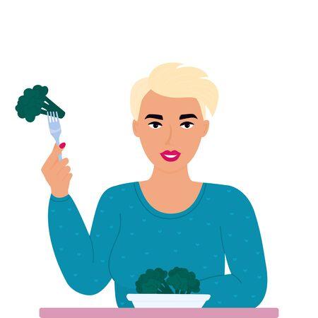 Vegetarian girl holds broccoli on a fork.