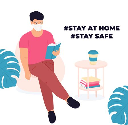 Learning at home. Man is reading a book. Quarantine during a coronavirus COVID-19. Self isolation. Guy getting ready for the exam