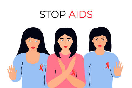 Young girls with red ribbons show gesture of stop AIDS.