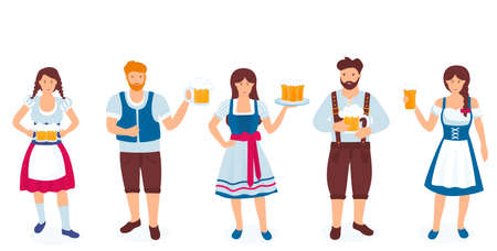A group of guys and girls in national German costumes are holding glasses of beer. Celebration of Oktoberfest.
