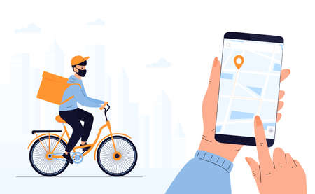 Quarantine. Delivery man in a protective mask delivers parcel by bike. Track shipments using the mobile application. Hand is holding smartphone