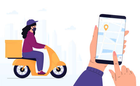 Delivery woman in a protective mask delivers parcel by motorbike. Track shipments using the mobile application.