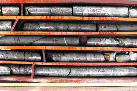Core samples stored in a box. Geological exploration studies.