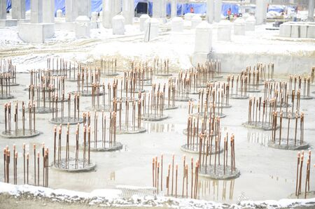 Filling the site with concrete. Construction of a petrochemical and oil refinery near the city of Tobolsk in Russia, workers working on the installation and construction of the plant. 写真素材