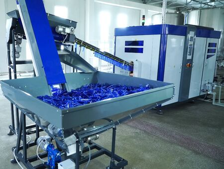 Filling line in plastic flasks. Liquid Filling Plant Reklamní fotografie