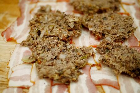 cooking meatloaf, minced meat with spices put in a roll.
