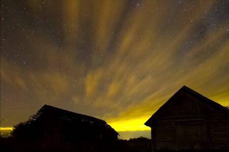 Starry sky background picture of stars in the night sky and the Milky Way. Starry sky over wooden houses in the village 版權商用圖片