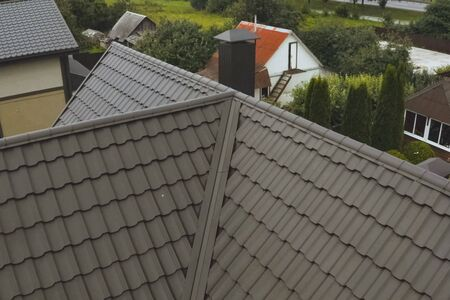 Modern roof made of metal. Corrugated metal roof and metal roofing. Stock fotó - 134740603