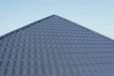 Modern roof made of metal. Corrugated metal roof and metal roofing. Stock fotó - 134740903
