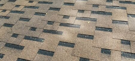 Bituminous tile for a roof. a roof from a bituminous tile. Stock fotó - 134732960
