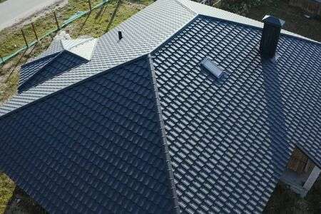 Modern roof made of metal. Corrugated metal roof and metal roofing. Stock fotó - 134742527