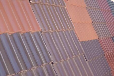Samples of ceramic roofing tiles in a warehouse of a roofing materials store. Modern roof made of metal. cement sand tiles. 写真素材