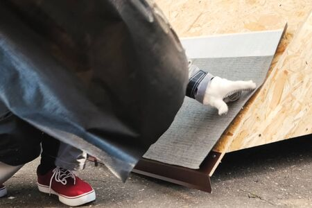Sticking roofing material on a wooden base. Roof Mounting Sample