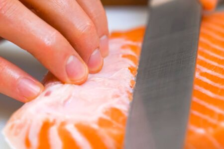 a Butchering salmon, piece of salmon red fish meat. 写真素材
