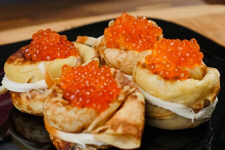 Pancakes with red caviar. red caviar food