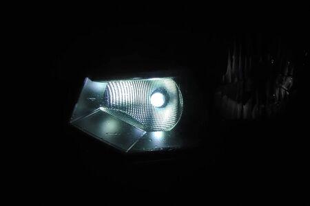 The xenon lamp in the car's headlight glows. 版權商用圖片