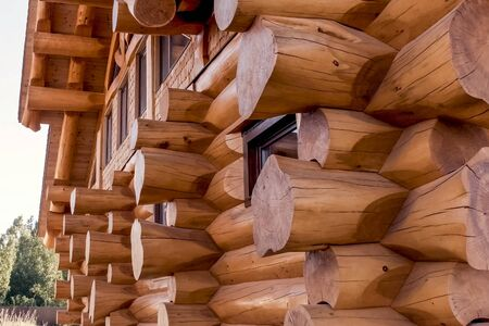 Details and elements of a wooden house made of timber. The construction of a wooden house.