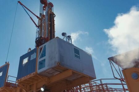Drilling rig, equipment at the site of oil drilling.