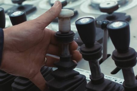 Hydraulic control levers. Drilling platform control panel.